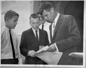 L to R: Andy Woods, Bob Cornell, Jim Stasny, partially hidden, and Attorney General Robert F. Kennedy